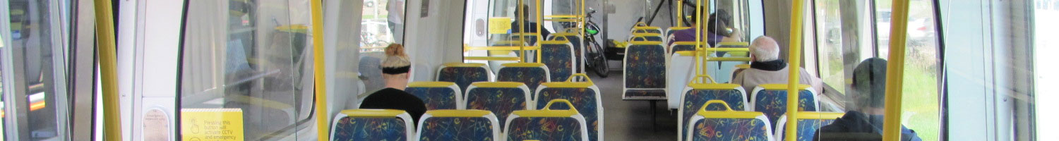 The familiy blue, yellow and white colour scheme of a Melbourne train interior.